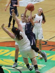 Watkins Glen's Hannah Morse (3) goes up for a shot against Cambridge during the class C championship at Hudson Valley Community College in Troy March 15, 2019. Cambridge won the game 57-43.