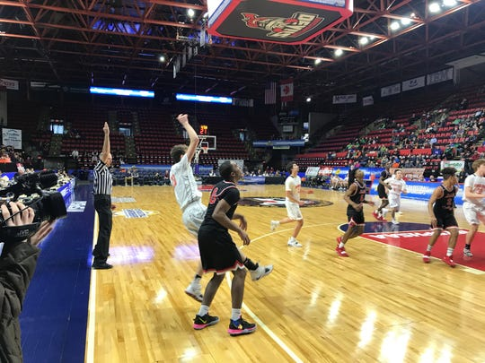 Cooperstown's Jack Lambert following through on a three-point shot in Sunday's Class C state final.