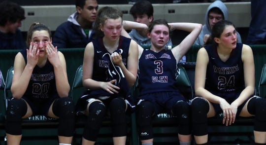 Watkins Glen players watch from the bench as Cambridge players celebrate their 57-43 victory in the New York State class C championship at Hudson Valley Community College in Troy March 15, 2019.