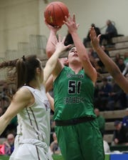 Seton Catholic's Julia Hauer (51) puts up a shot against  Mendon during the girls Class A state championship game at Hudson Valley Community College in Troy March 17, 2019.