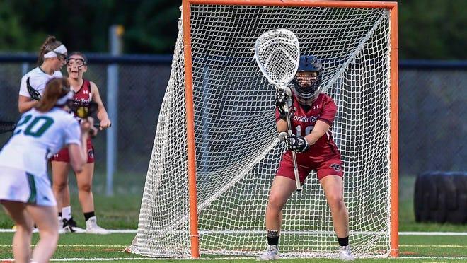 FIT women's lacrosse in action.