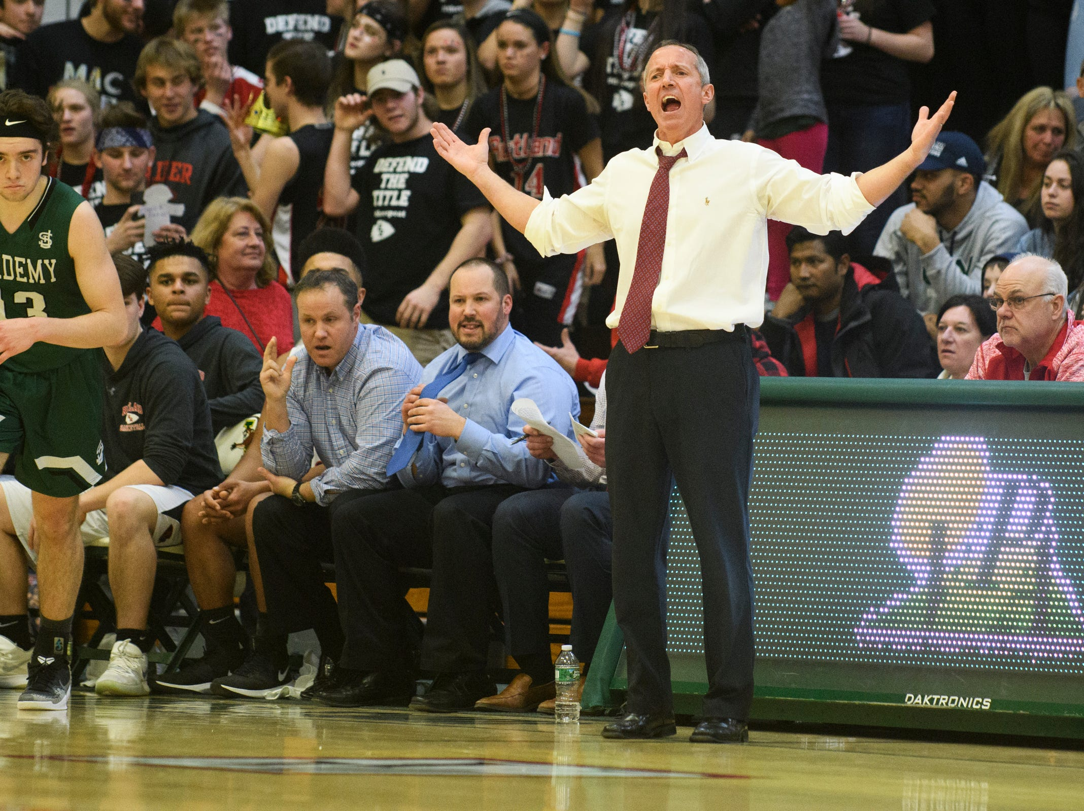 Rutland head coach Mike Wood questions a call on the court during the DI boys basketball championship game between the St. Johnsbury Hilltoppers and the Rutland Raiders at Patrick Gym on Sunday afternoon March 17, 2019 in Burlington, Vermont.