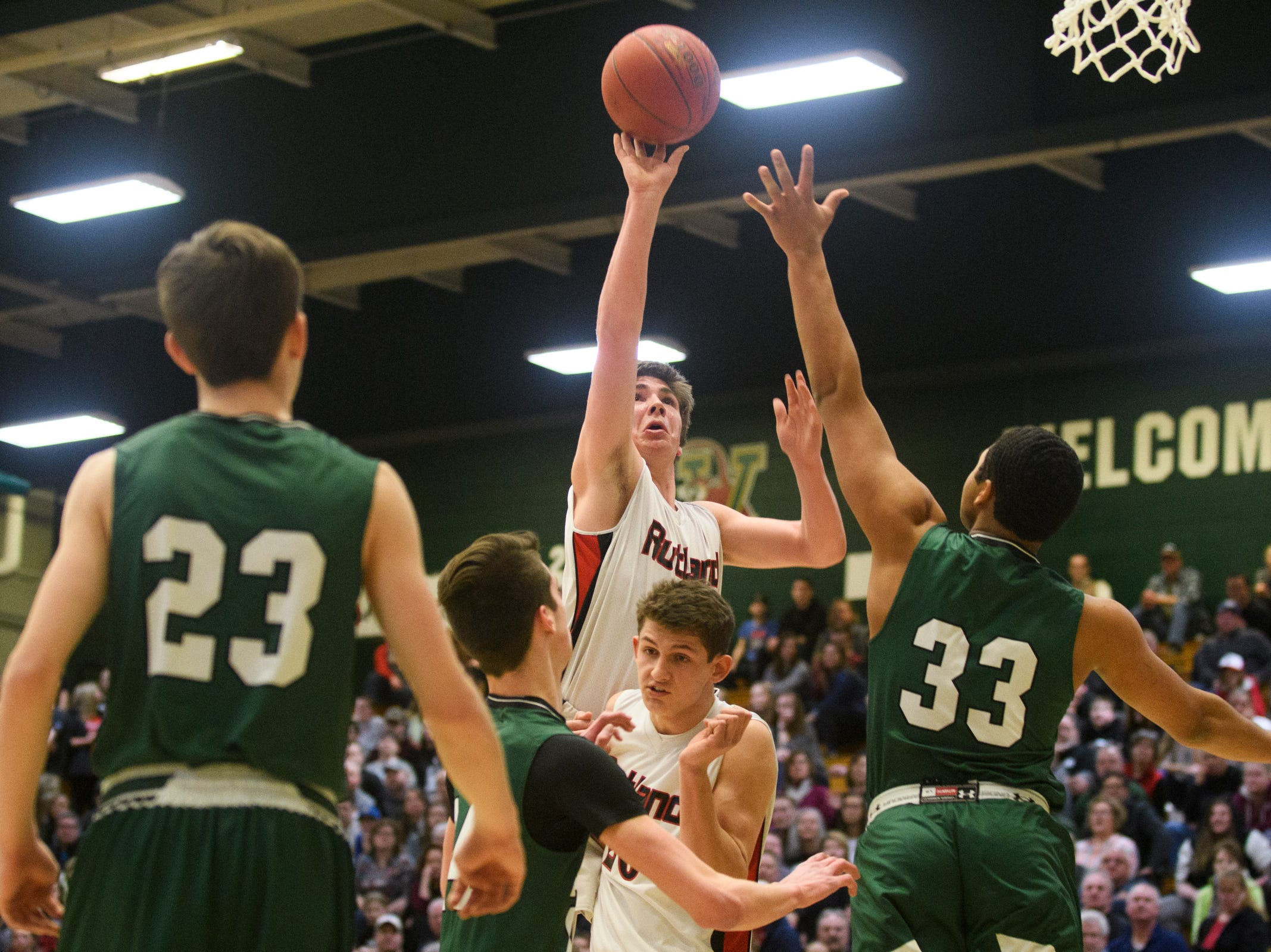 Rutland's Jacob Lorman (24) leaps to take a shot during the DI boys basketball championship game between the St. Johnsbury Hilltoppers and the Rutland Raiders at Patrick Gym on Sunday afternoon March 17, 2019 in Burlington, Vermont.