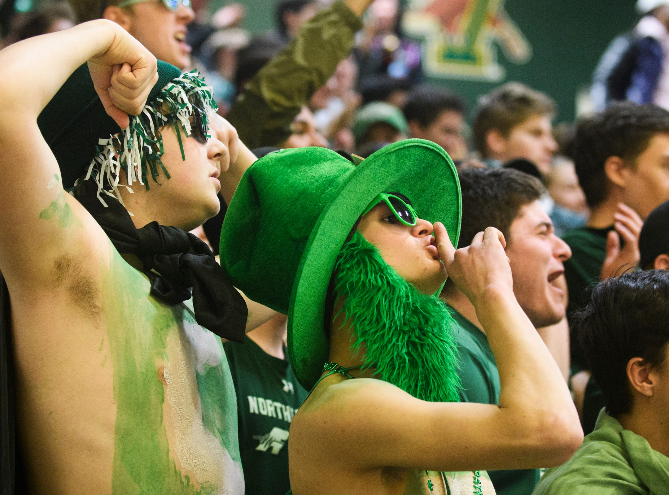 St. Johnsbury fans cheer for the team during the DI boys basketball championship game between the St. Johnsbury Hilltoppers and the Rutland Raiders at Patrick Gym on Sunday afternoon March 17, 2019 in Burlington, Vermont.