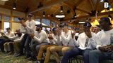 UVM men's basketball team and fans cheer as they are announced during the NCAA March Madness tournament schedule. UVM will face Florida State.