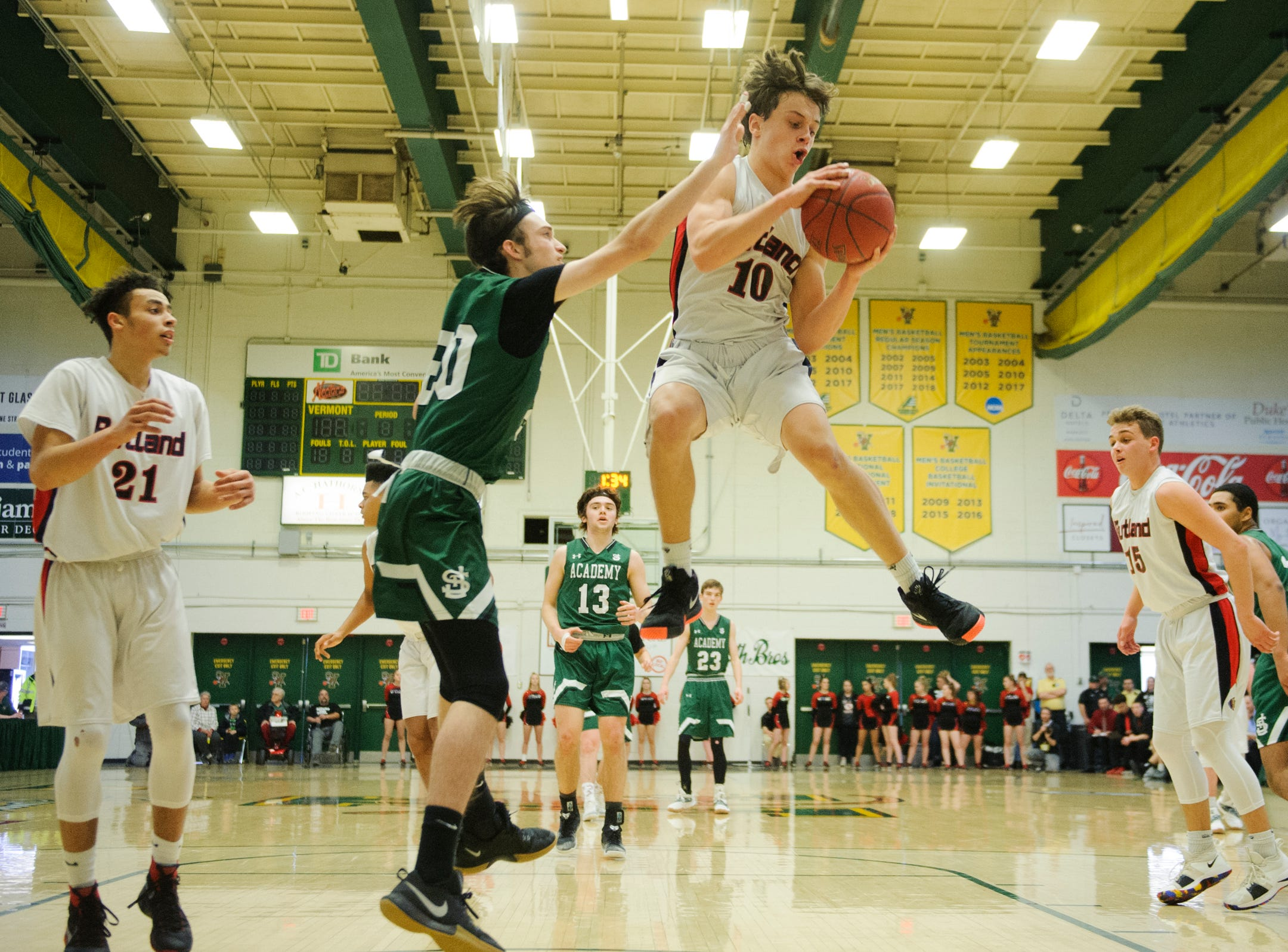 Rutland's Evan Pocket (10) leaps to grab the rebound during the DI boys basketball championship game between the St. Johnsbury Hilltoppers and the Rutland Raiders at Patrick Gym on Sunday afternoon March 17, 2019 in Burlington, Vermont.