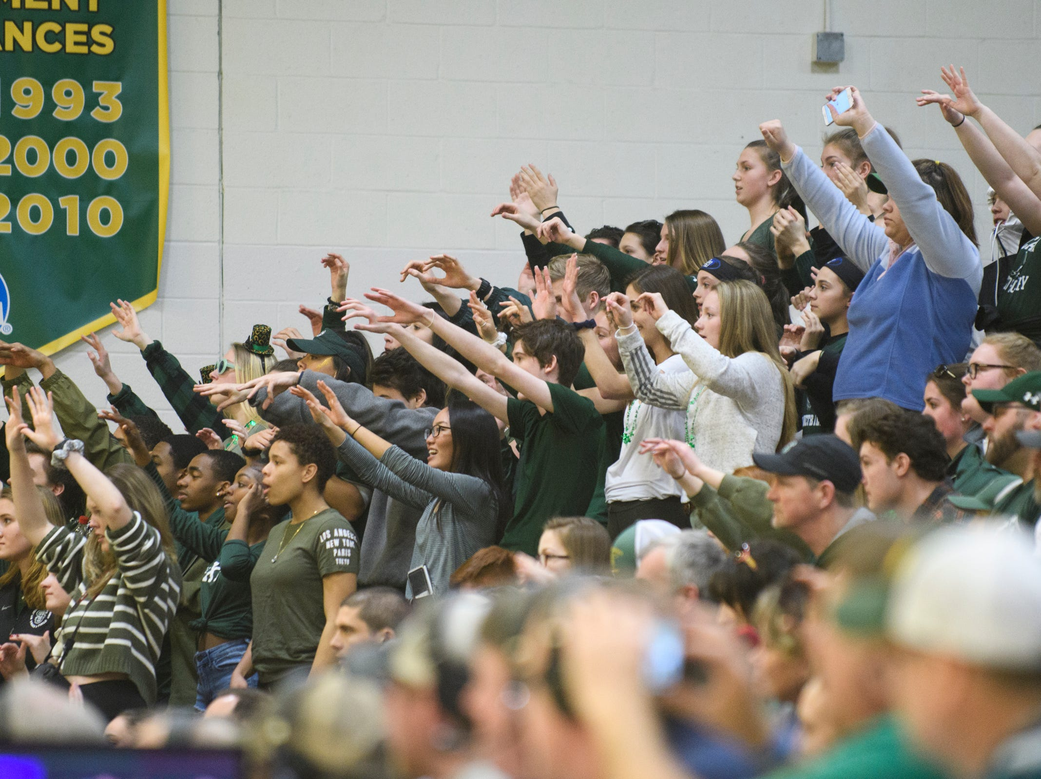 St. johnsbury fans hold up their hands during a free throw attempt in the DI boys basketball championship game between the St. Johnsbury Hilltoppers and the Rutland Raiders at Patrick Gym on Sunday afternoon March 17, 2019 in Burlington, Vermont.