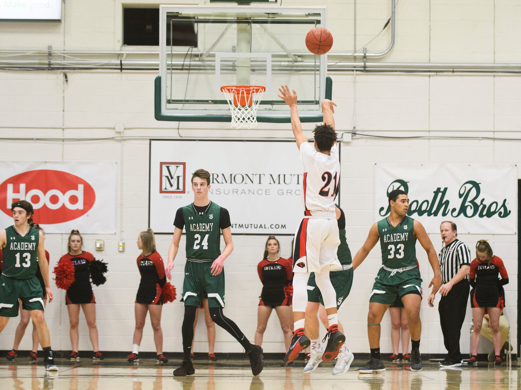 Rutland's Jamison Evans (21) shoots a three pointer during the DI boys basketball championship game between the St. Johnsbury Hilltoppers and the Rutland Raiders at Patrick Gym on Sunday afternoon March 17, 2019 in Burlington, Vermont.