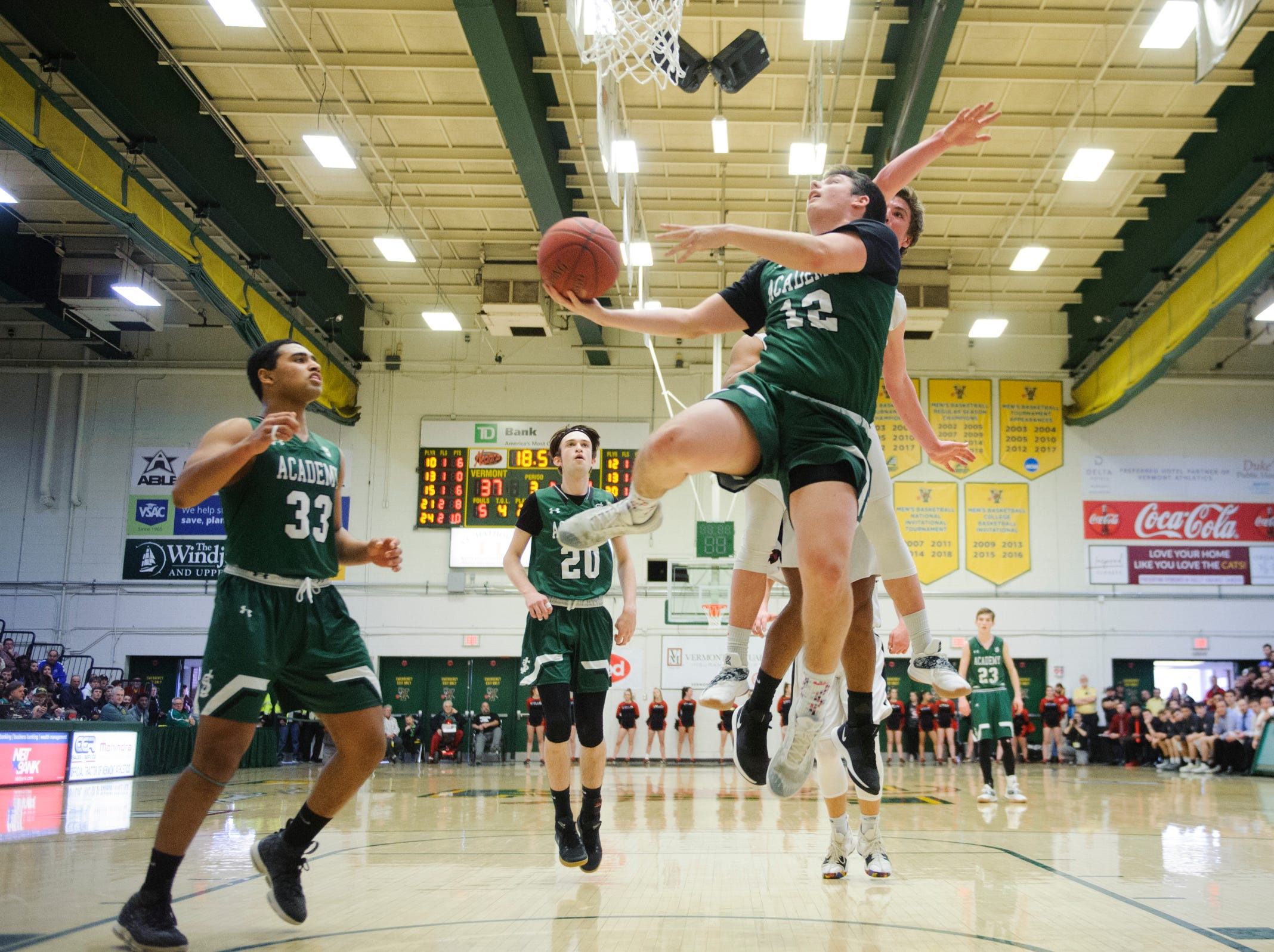St. Johnsbury's Nic Guckin (12) leaps for a lay up during the DI boys basketball championship game between the St. Johnsbury Hilltoppers and the Rutland Raiders at Patrick Gym on Sunday afternoon March 17, 2019 in Burlington, Vermont.