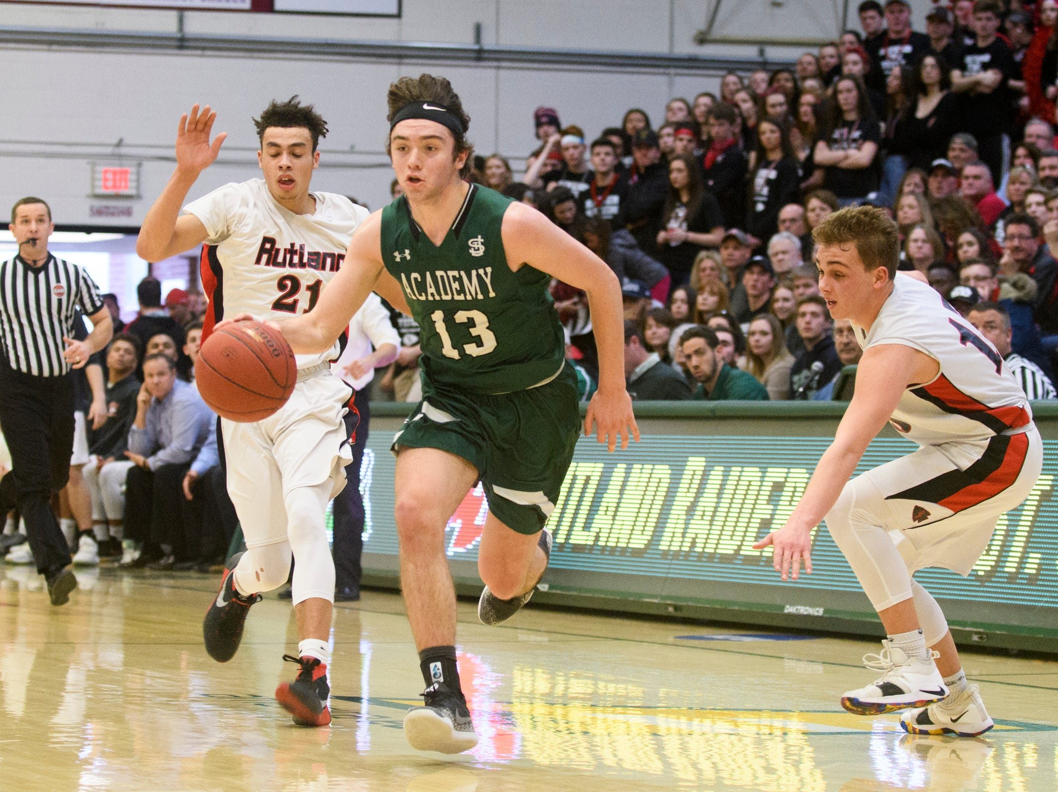 St. Johnsbury's Alex Carlisle (13) drives to the hoop during the DI boys basketball championship game between the St. Johnsbury Hilltoppers and the Rutland Raiders at Patrick Gym on Sunday afternoon March 17, 2019 in Burlington, Vermont.