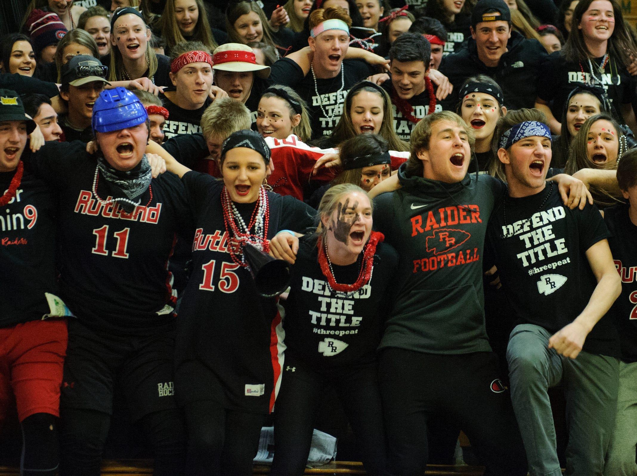 Rutland fans cheer for the team during the DI boys basketball championship game between the St. Johnsbury Hilltoppers and the Rutland Raiders at Patrick Gym on Sunday afternoon March 17, 2019 in Burlington, Vermont.