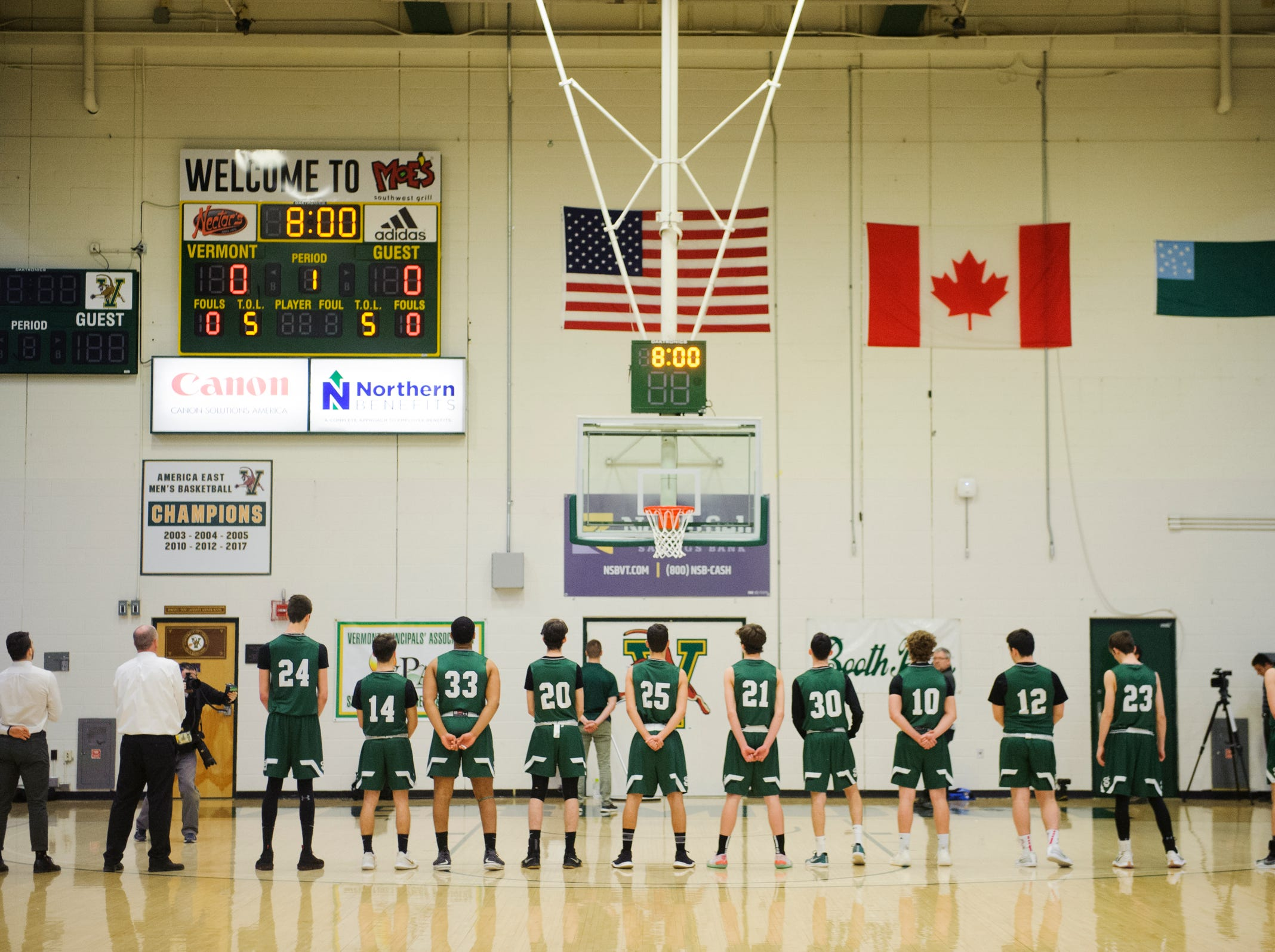 St. Johnsbury listens to the National Anthem during the DI boys basketball championship game between the St. Johnsbury Hilltoppers and the Rutland Raiders at Patrick Gym on Sunday afternoon March 17, 2019 in Burlington, Vermont.
