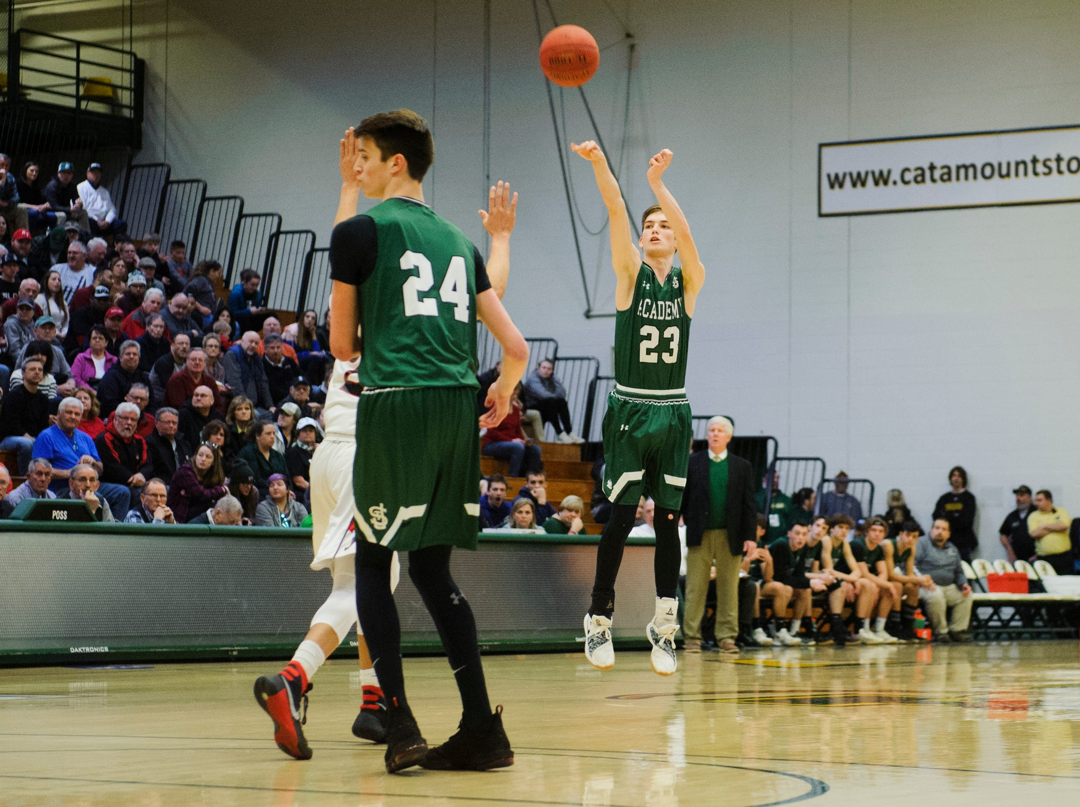 St. Johnsbury's Logan Wendell (23) shoots the ball during the DI boys basketball championship game between the St. Johnsbury Hilltoppers and the Rutland Raiders at Patrick Gym on Sunday afternoon March 17, 2019 in Burlington, Vermont.