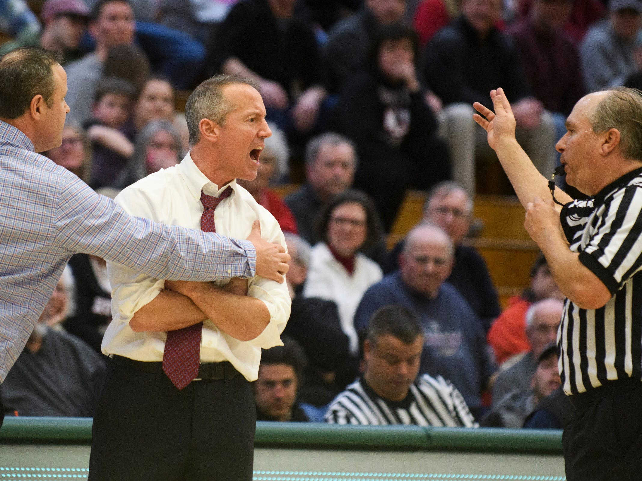 Rutland head coach Mike Wood talks to the referee during the DI boys basketball championship game between the St. Johnsbury Hilltoppers and the Rutland Raiders at Patrick Gym on Sunday afternoon March 17, 2019 in Burlington, Vermont.