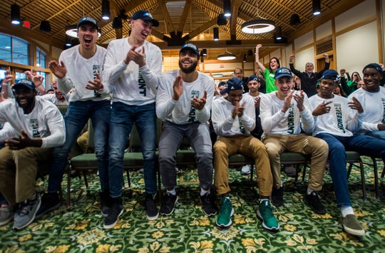 The University of Vermont men's basketball team celebrates after the announcement of their first game in the NCAA tournament on Sunday, March 17, 2019. UVM will face Florida State.