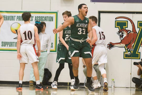 St. Johnsbury's Asom Hayman-Jones (34) celebrates a basket during the DI boys basketball championship game between the St. Johnsbury Hilltoppers and the Rutland Raiders at Patrick Gym on Sunday afternoon March 17, 2019 in Burlington, Vermont.