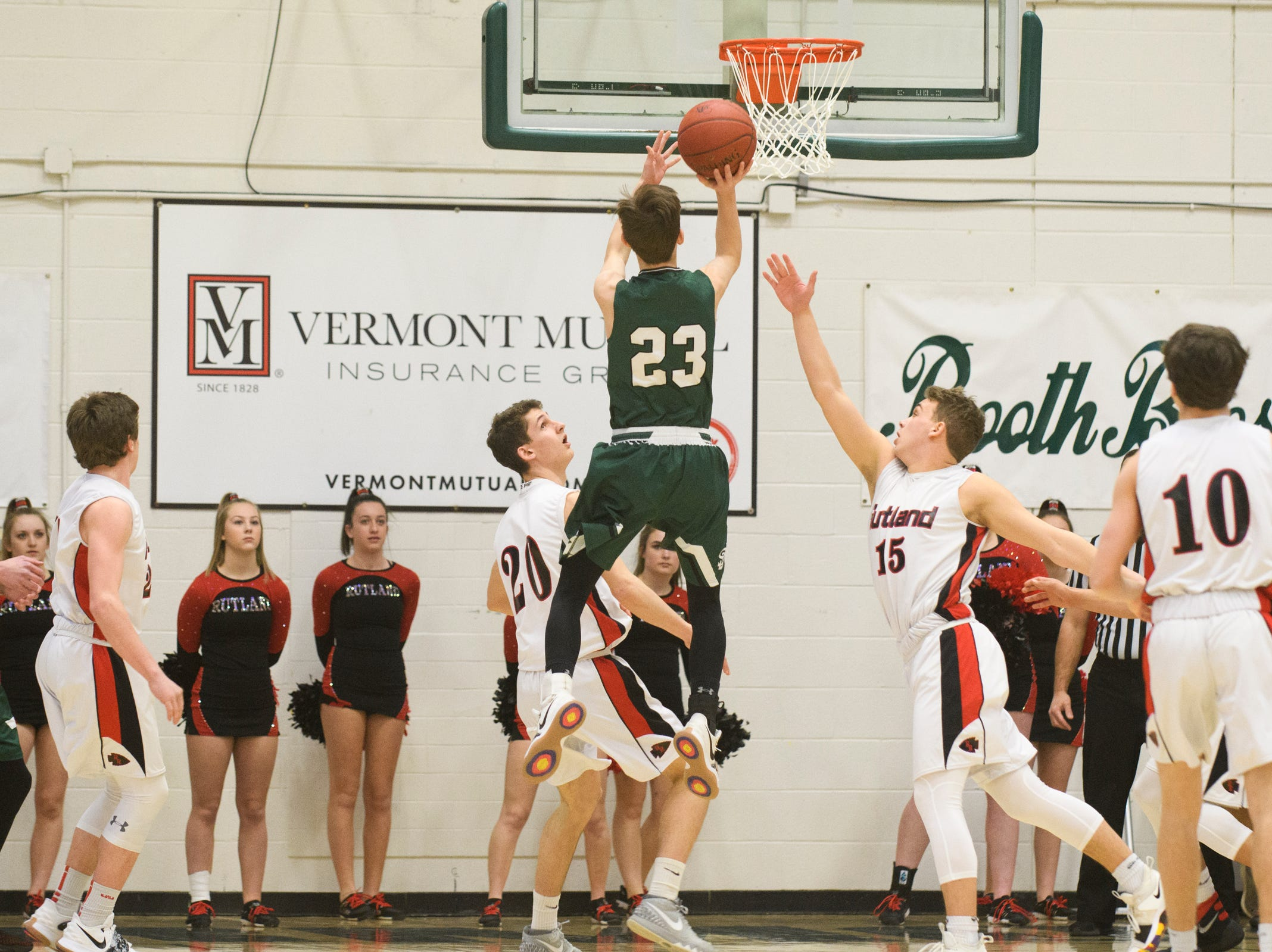 St. Johnsbury's Logan Wendell (23) leaps to take a shot during the DI boys basketball championship game between the St. Johnsbury Hilltoppers and the Rutland Raiders at Patrick Gym on Sunday afternoon March 17, 2019 in Burlington, Vermont.