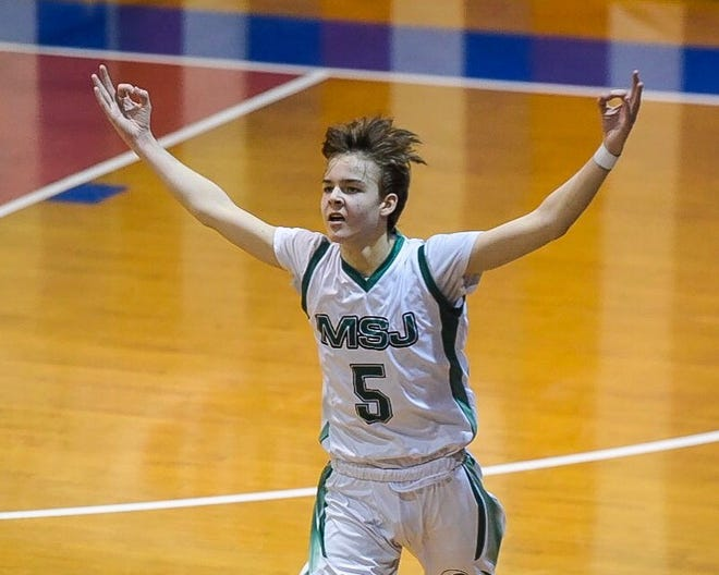 MSJ's Maddox Traynor reacts to a first-half 3 during the Green Wave's win over Lake Region in the Division II championship at Barre Auditorium on Saturday, March 16, 2019.