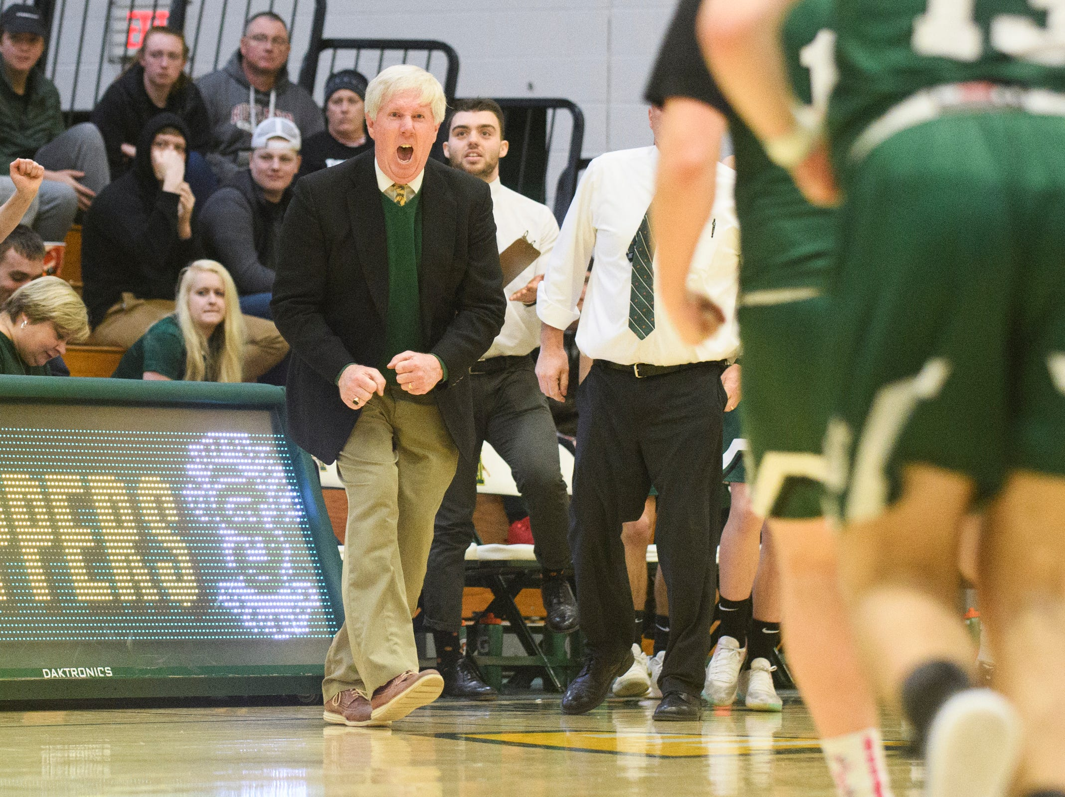 St. Johnsbury head coach David McGinn celebrates during the DI boys basketball championship game between the St. Johnsbury Hilltoppers and the Rutland Raiders at Patrick Gym on Sunday afternoon March 17, 2019 in Burlington, Vermont.