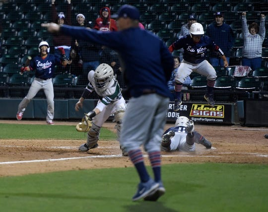 Several Veterans Memorial players celebrate Jake Rabe scoring in the eleventh inning against King, Saturday, March 16, 2019, at Whataburger Field.