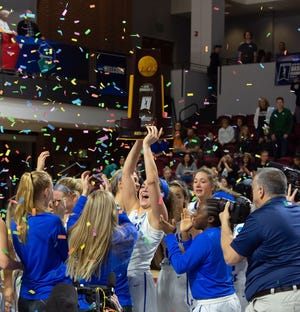 The Thomas More women celebrate their Division III national championship on Saturday, March 16.