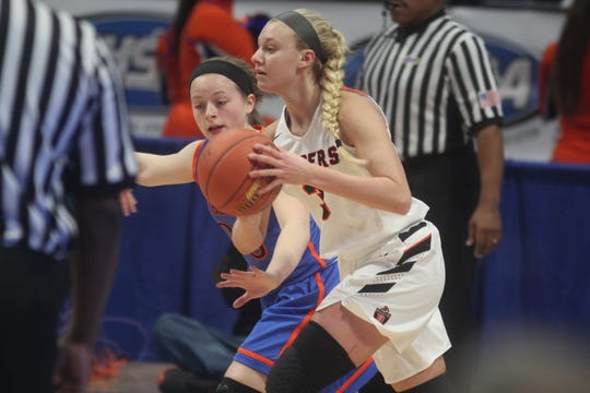 Ryle sophomore Brie Crittendon looks for an opening as Ryle defeated Southwestern 63-48 in the KHSAA Sweet 16 girls basketball state championship game March 17, 2019 at Rupp Arena, Lexington KY. Ryle won its first state championship and the second by a Northern Kentucky girls program.