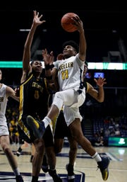 Moeller guard Miles McBride scores in the boys regional final against Centerville at the Cintas Center at Xavier University. Moeller defeated Centerville 59-41 and will move on to the Final Four in Columbus.