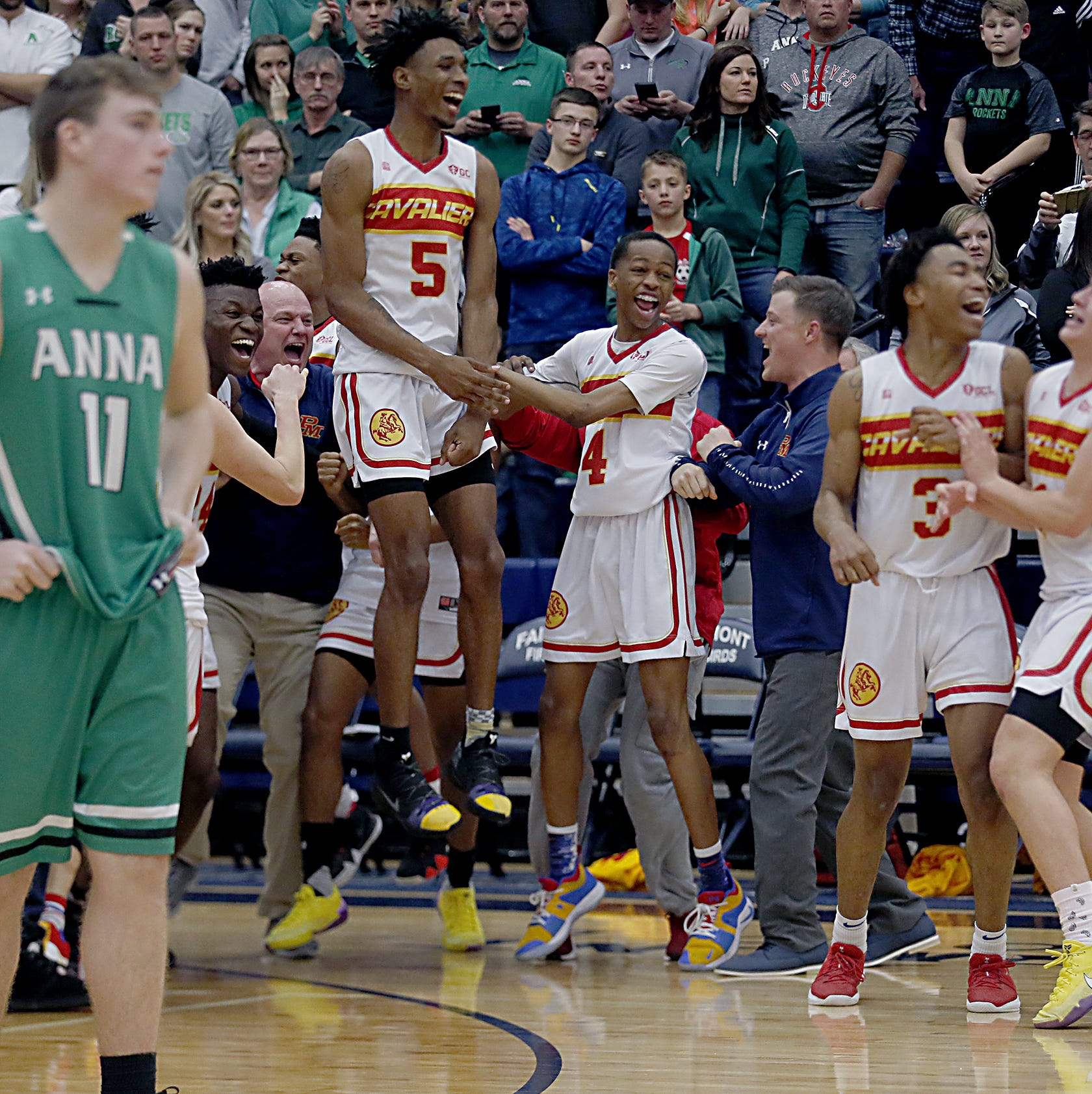 Purcell Marian reacts as time expires in their Division III regional final victory over Anna at Trent Arena in Kettering Saturday, March 16, 2019.