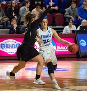 Thomas More's Madison Temple drives to the basket in the Division III national championship game.