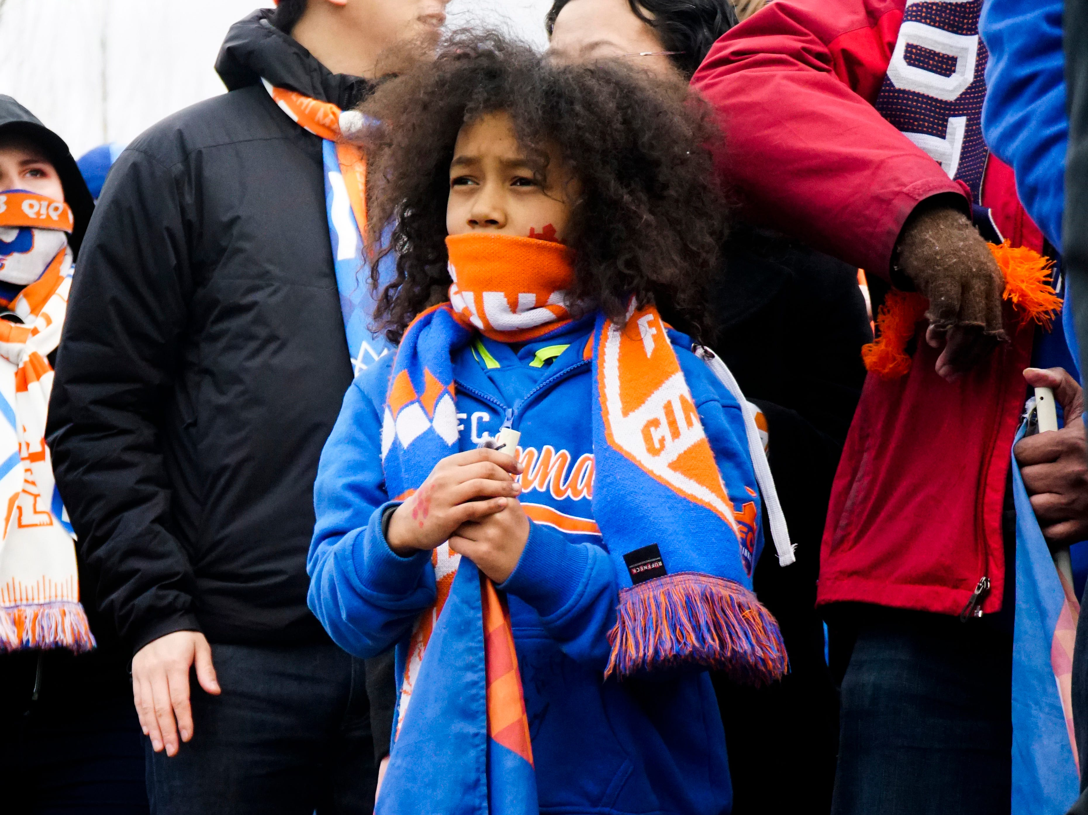 Maxfield Aloway, age eight, waits with his parents and other FC Cincinnati fans before marching to Nippert Stadium, March 17, 2019.