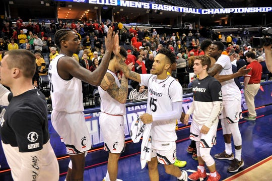 Cincinnati Bearcats players celebrate after the game against the Wichita State Shockers in the American Athletic Conference Tournament at FedExForum.