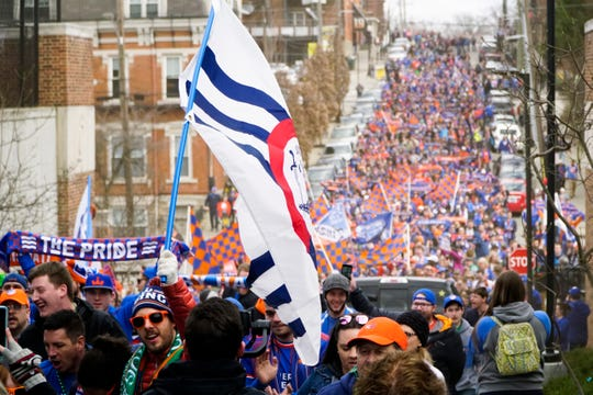 Fans stream towards Nippert Stadium before  the first FC Cincinnati home game against Portland at, March 17, 2019.