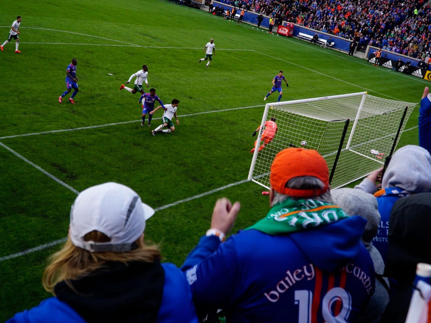 Fans celebrate back-to-back goals in the second half in FC Cincinnati's home game against Portland at Nippert Stadium, March 17, 2019