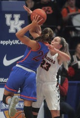 Ryle junior Maddie Scherr blocks the shot of Southwestern senior Kallie Sheron as Ryle defeated Southwestern 63-48 in the KHSAA Sweet 16 girls basketball state championship game March 17, 2019 at Rupp Arena, Lexington KY. Ryle won its first state championship and the second by a Northern Kentucky girls program.