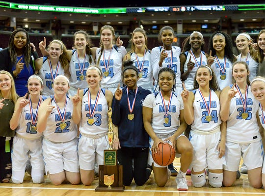 Mount Notre Dame players celebrate after beating Pickerington Central in the OHSAA Division I Championship at the Shottenstein Center in Columbus, OH, Saturday, March 16, 2019.