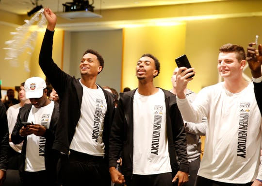 Dantez Walton, left, Jalen Tate, and Drew McDonald of The Northern Kentucky University Norse celebrate after hearing they will face Texas Tech Friday in Tulsa in the NCAA Tournament.  The Norse earned at No. 14 seed, thus a matchup with a No. 3 seed. Photo shot Sunday March 17, 2019.