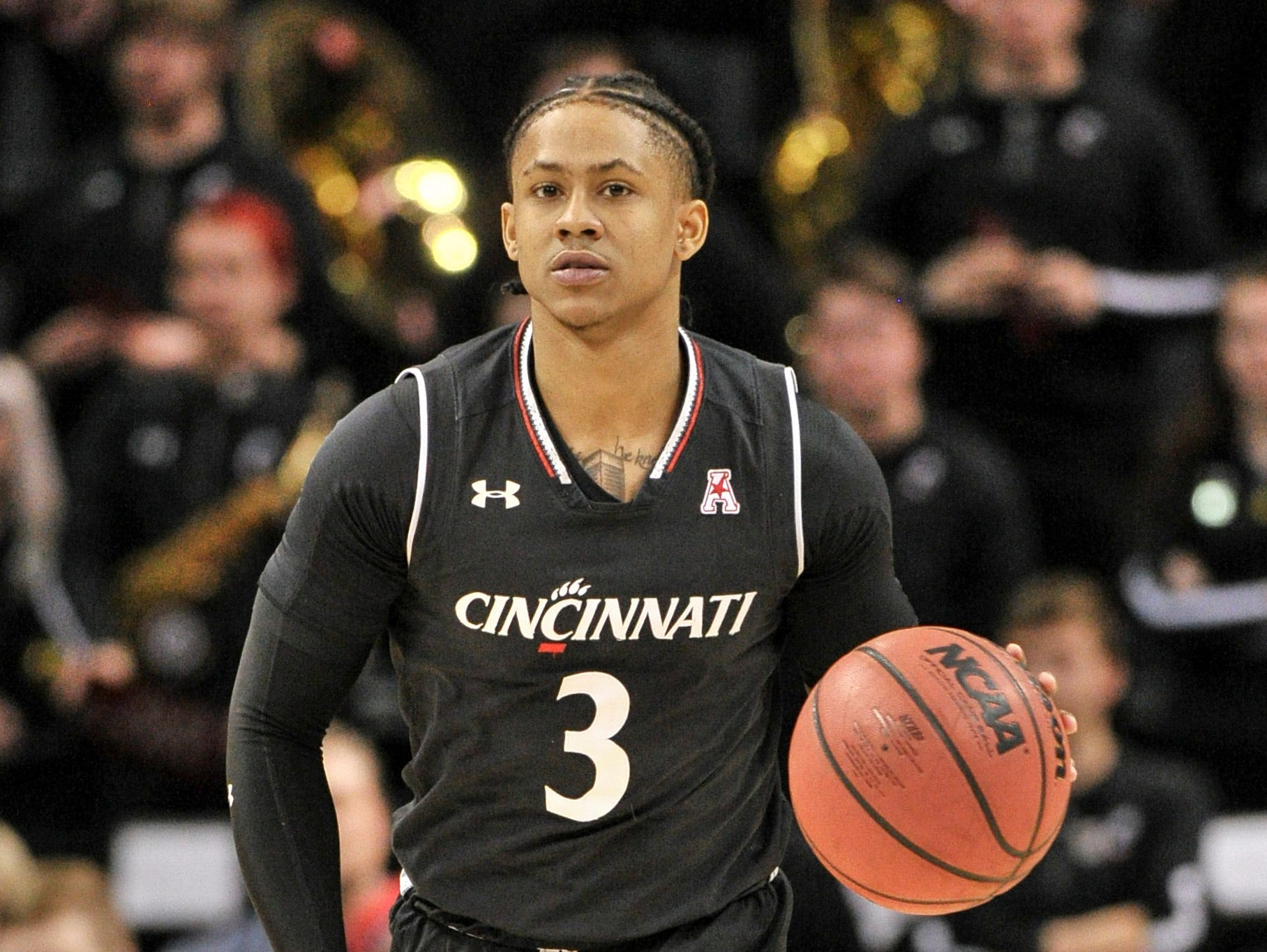 Cincinnati Bearcats guard Justin Jenifer (3) brings the ball up court during the first half against the Houston Cougars in the American Athletic Conference Tournament at FedExForum.
