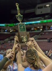 Mount Notre Dame players hold up the hardware after beating Pickerington Central in the OHSAA Division I Championship at the Shottenstein Center in Columbus, OH, Saturday, March 16, 2019.