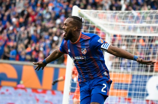 FC Cincinnati defender Kendall Waston (2) celebrates after scoring a goal in the first half of the MLS match between FC Cincinnati and Portland Timbers on Sunday, March 17, 2019, at Nippert Stadium in Cincinnati.