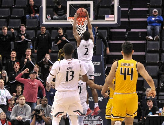 Cincinnati Bearcats guard Keith Williams (2) dunks against Wichita State Shockers forward Isaiah Poor Bear-Chandler (44) during the second half in the American Athletic Conference Tournament at FedExForum.