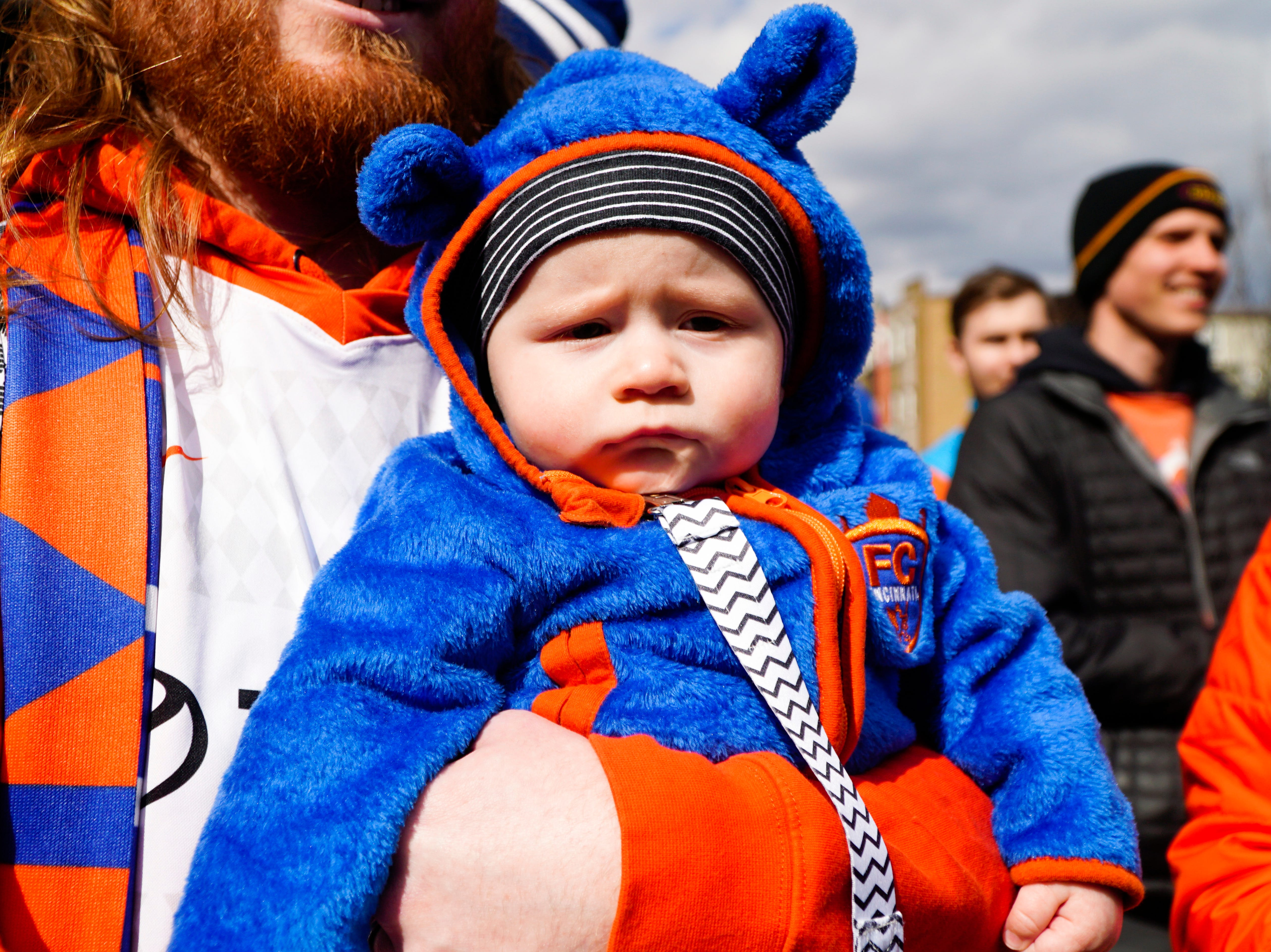 Ben James held his two month-old son Klay as FC Cincinnati fans streamed towards Nipper Stadium, March 17, 2019.