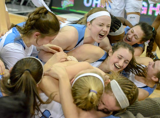 Mount Notre Dame players celebrate after beating Pickerington Central in the OHSAA Division I Championship at the Shottenstein Center in Columbus, OH, Saturday, March 16, 2019