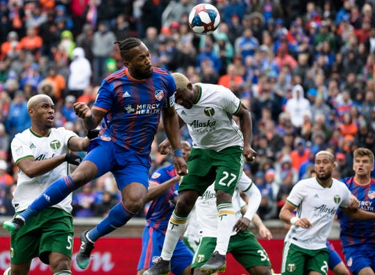 FC Cincinnati defender Kendall Waston (2) heads the ball as Portland Timbers forward Dairon Asprilla (27) guards him in the first half of the MLS match between FC Cincinnati and Portland Timbers on Sunday, March 17, 2019, at Nippert Stadium in Cincinnati.