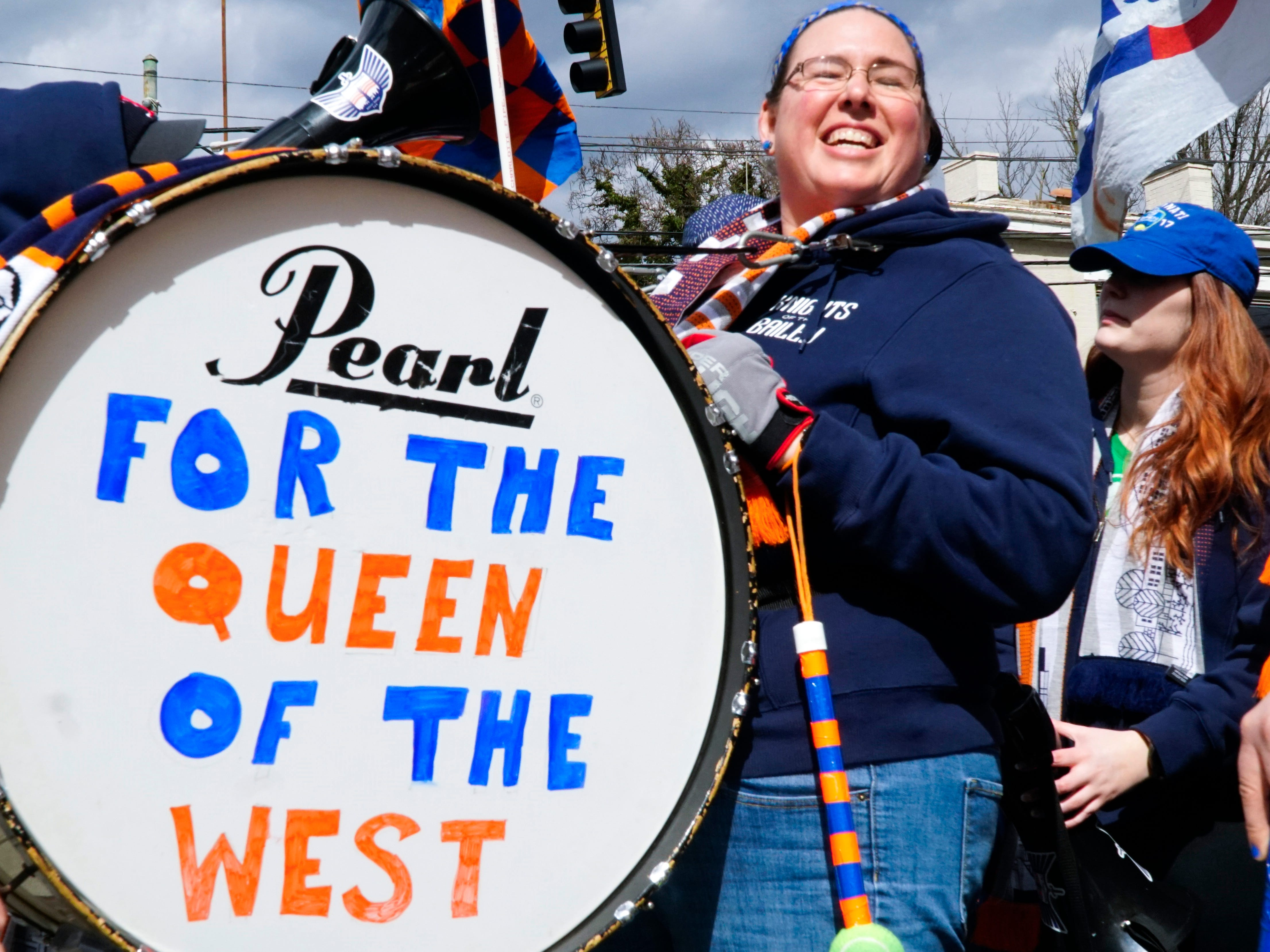 Tiffany Brumberg and her husband Bob beat drums at the head of a mob of FC Cincinnati fans headed to Nippert Stadium for the FCC home opener against Portland, March 17, 2019.