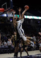 Moeller guard Max Land scores in the boys regional final against Centerville at the Cintas Center at Xavier University. Moeller defeated Centerville 59-41 and will move on to the Final Four in Columbus.