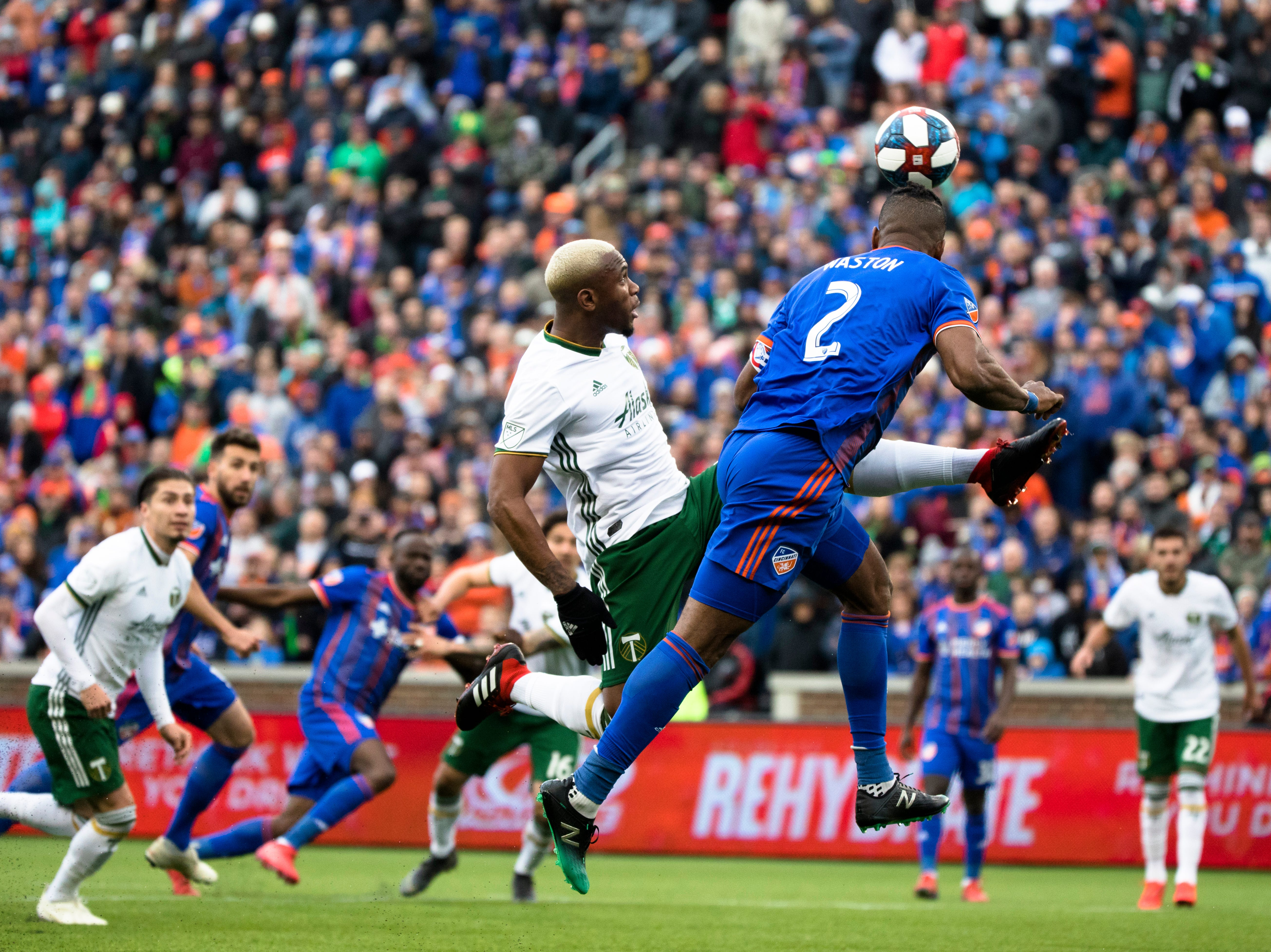 FC Cincinnati defender Kendall Waston (2) scores a goal as Portland Timbers defender Claude Dielna (5) attempts to stop him in the first half of the MLS match between FC Cincinnati and Portland Timbers on Sunday, March 17, 2019, at Nippert Stadium in Cincinnati.