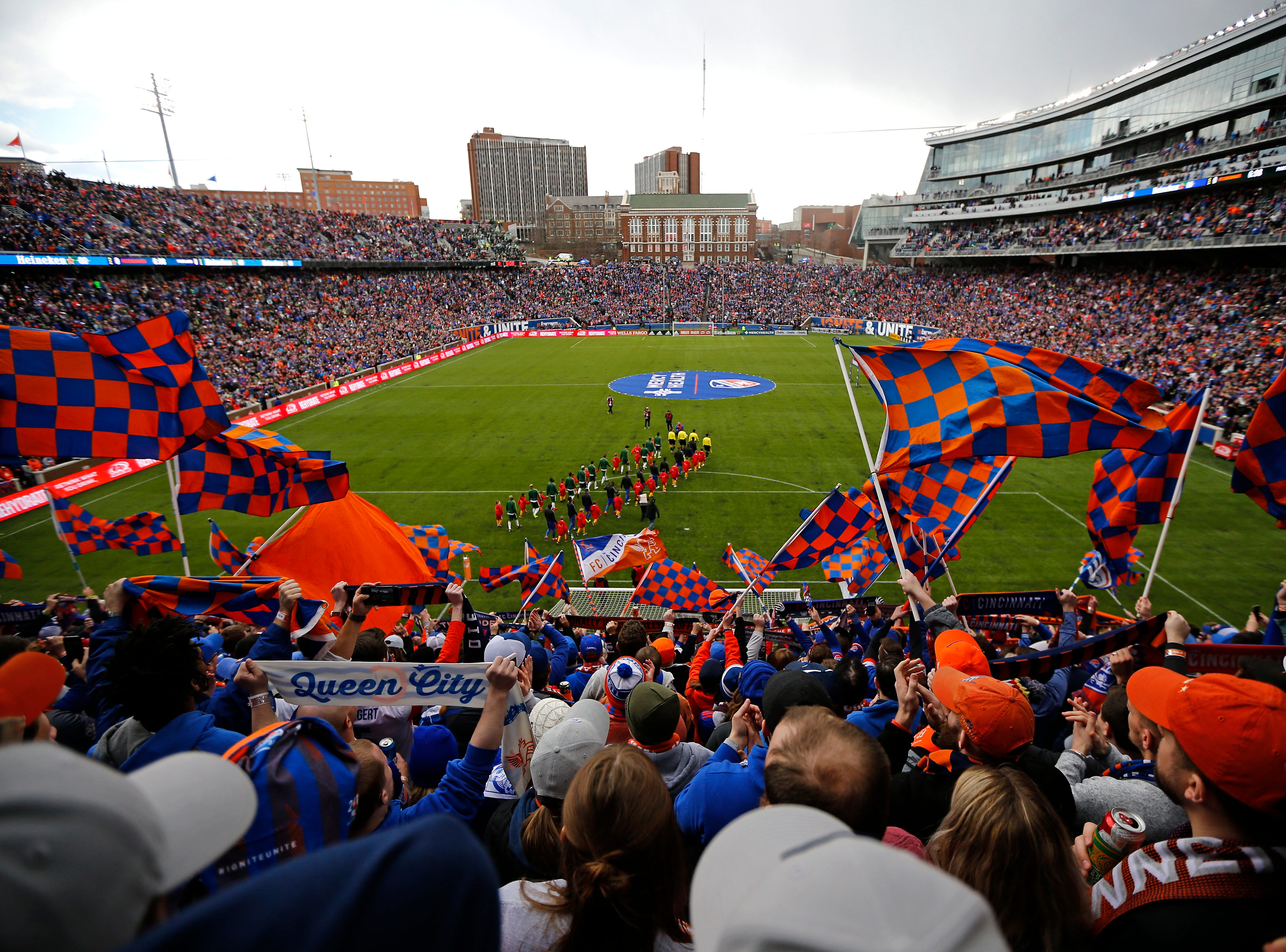 The Bailey cheers and waves flags as both teams take the field before the the first half of the MLS match between FC Cincinnati and the Portland Timbers at Nippert Stadium in Cincinnati on Sunday, March 17, 2019. FC Cincinnati led 1-0 at halftime.
