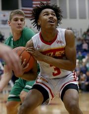 Purcell Marian's Clarke Jefferson grabs a rebound against Anna during their Division III regional final at Trent Arena in Kettering Saturday, March 16, 2019.