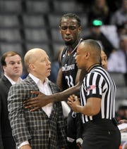 Cincinnati Bearcats head coach Mick Cronin talks with the referee during the first half against the Houston Cougars in the American Athletic Conference Tournament at FedExForum.