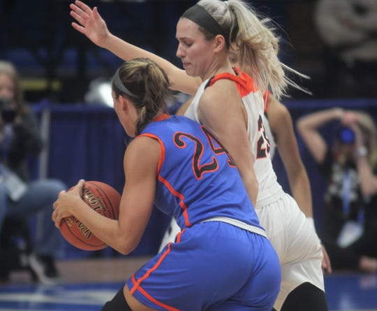 Ryle junior Maddie Scherr pressures Southwestern senior Kallie Sheron as Ryle defeated Southwestern 63-48 in the KHSAA Sweet 16 girls basketball state championship game March 17, 2019 at Rupp Arena, Lexington KY. Ryle won its first state championship and the second by a Northern Kentucky girls program.